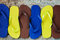 Several pairs of multi-colored rubber flip-flops exhibited in a