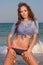 Stock Image : Sexy beautiful woman sitting at the beach