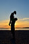 Stock Image : Silhouette of Father and daughter on the Beach