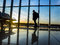 Stock Image : Silhouette of man near window in airport