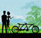 Stock Image : Sillhouette of sweet young couple in love standing in the park