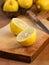 Stock Image : Sliced lemons on a cutting board