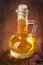 Stock Image : Small bottle with sunflower oil on old wooden board