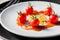 Stock Image : Small tomato and beans on white dish of bio food stylish