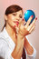Stock Image : Smartens up with compact mirror