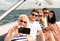 Stock Image : Smiling friends sitting on yacht deck