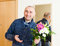 Stock Image : Smiling man with  bouquet