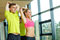 Stock Image : Smiling man and woman exercising in gym
