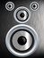 Stock Image : Speaker on a silver metal texture
