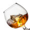 Stock Image : Splash of whiskey with ice in glass isolated