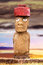 Stock Image : Standing moai with red stone hat and large eyes in Easter Island, Chil