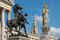 Stock Image : Statues in front of Vienna parliament, Rathaus in background