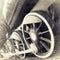 Stock Image : Steam locomotive wheels close up in retro black an