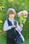 Stock Image : Student boy in school uniform with a bouquet of flowers