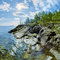 Stock Image : Sun and stony shore of Ladoga lake