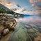 Stock Image : Sunrise on Rocky Beach and Small Village near Omis, Dalmatia