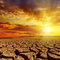 Stock Image : Sunset in cloudy sky over desert