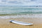 Stock Image : Surfboard lying on sand near the ocean