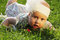 Stock Image : Surprised baby on green grass