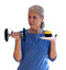 Stock Image : Surprised Woman Holding Dumbbell and Cupcake