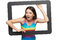 Stock Image : Surprised young woman scrambling out of tablet frame