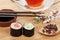 Stock Image : Sushi maki set, herbal tea and sakura branch