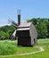 Stock Image : Suspendet windmill near lake