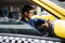 Stock Image : Taxi driver driving car happy counting money