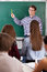 Stock Image : Teacher in front of a chalkboard