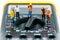 Stock Image : Team of miniature workers on top of multimeter. Macro photo