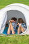 Stock Image : Teenage boy and girl near a white tent