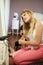 Stock Image : Teenage Girl Drying Hair In Bedroom