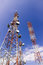 Stock Image : Telecommunication tower , AM radio and TV broadcast tower against blue sky background