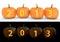 Stock Image : 2013 text carved on pumpkin jack lantern