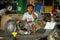 Stock Image : Thaise werktuigkundige in autoreparatie