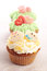 Stock Image : Three cupcakes decorated with icing and marzipan decorations.