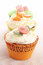 Stock Image : Three cupcakes decorated with marzipan decorations