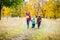 Stock Image : Three kids walking in autumn park