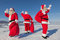 Stock Image : Three  Santa Claus outdoors