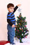 Stock Image : Three year old Christmas boy and little Christmas tree