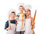 Stock Image : Three young chefs with ladle and rolling pin