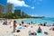 Stock Image : Tourist sunbathing and surfing on Waikiki beach on Hawaii Oahu
