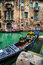 Stock Image : Tourists travel on gondolas at canal