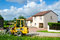 Stock Image : Tractor near house