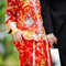 Stock Image : Traditional chinese wedding dress  and western tuxedo