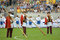 Stock Image : Trumpeters dressed in national costumes before the match