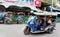 Stock Image : Tuk Tuk or sam-lor run through the streets