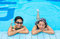 Stock Image : Two Asian girls are relaxing in the swimming pool corner