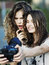 Stock Image : Two beautiful young happy girls make self-photo
