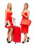 Stock Image : Two blonde girls wearing red dresses with big suitcase and bag